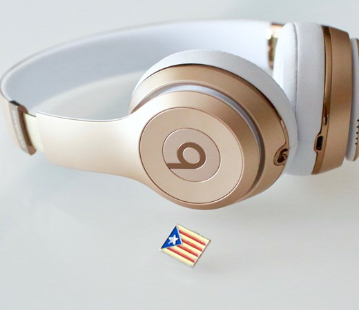 Beats headphones on a desk with a small American flag